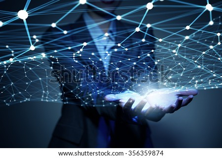 Businesswoman hand demonstrating digital connection lines in palm - stock photo