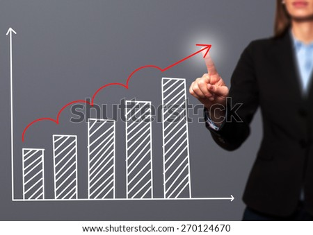 Businesswoman hand drawing growth graph on visual screen. Isolated on grey. Women finger on graph.  Business, internet, technology concept. Stock Image - stock photo