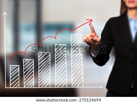Businesswoman hand drawing growth graph on visual screen. Isolated on office. Women finger on graph.  Business, internet, technology concept. Stock Image - stock photo