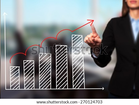 Businesswoman hand drawing growth graph on visual screen. Isolated on office. Women finger on graph.  Business, internet, technology concept. Stock Image