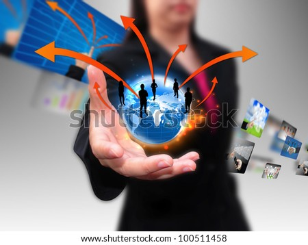 businesswoman hand holding business world