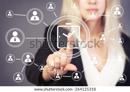 Businesswoman hand press clock time button icon web - stock photo