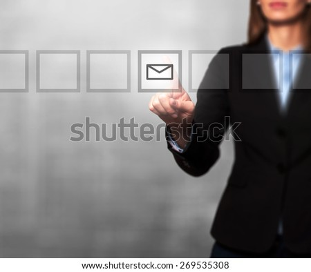 Businesswoman hand press mail icon button on visual screen. Women finger on mail icon. Isolated on grey. Business, technology, internet concept. Stock Image - stock photo