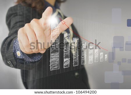 businesswoman hand touch virtual graph,chart, diagram - stock photo