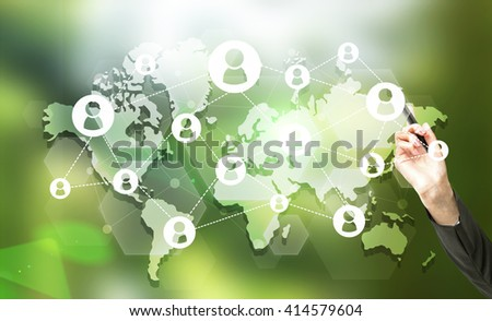 Businesswoman hand with marker pointing at map with social network on green background - stock photo