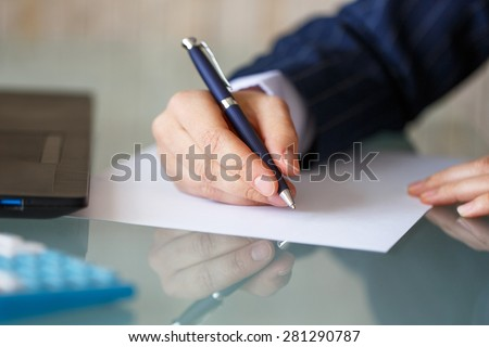 Businesswoman hand write on blank paper, closeup
