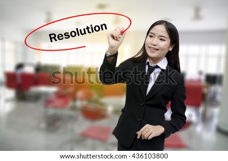 Businesswoman Hand writing Resolution with black marker on visual screen. Isolated on gray background. Business, technology, internet concept. Stock Photo