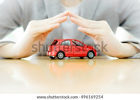 Businesswoman hands and car as protection of car concept