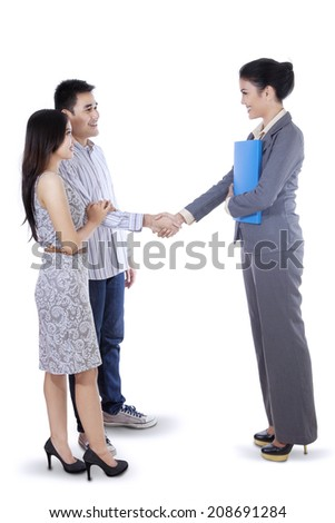 Businesswoman handshaking with her customer - stock photo