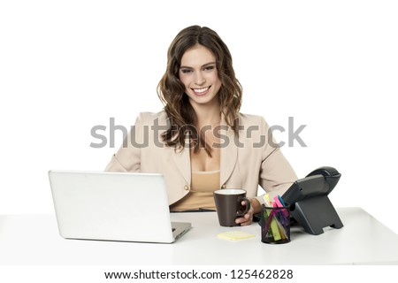 Businesswoman happy with her work - stock photo