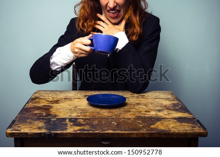 Businesswoman has had a very bad cup of coffee - stock photo