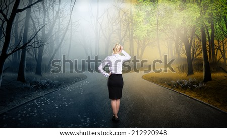 businesswoman has to decide which direction is better  - stock photo