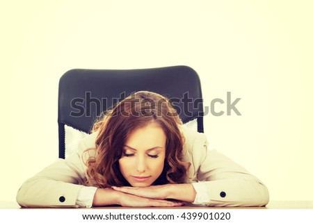 Businesswoman having a nap at her desk. - stock photo