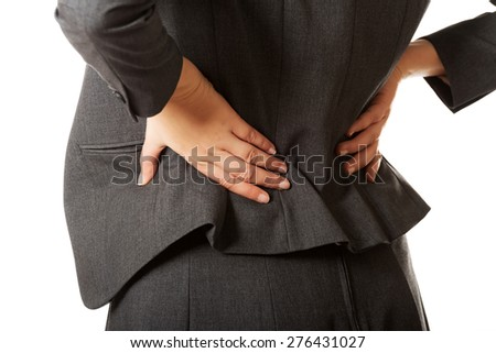 Businesswoman having huge back pain