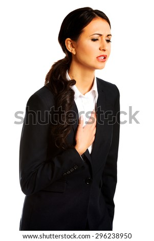Businesswoman having strong heart disease. - stock photo
