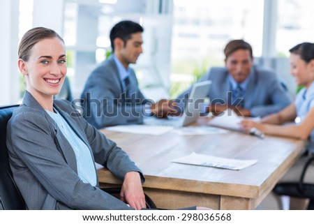 Businesswoman hiding her finger during meeting in office - stock photo