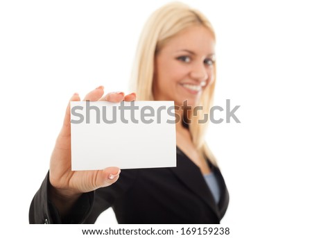 Businesswoman holding a blank business card. Selective focus on blank business card. - stock photo