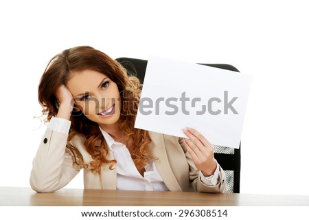 Businesswoman holding a blank paper sheet. - stock photo