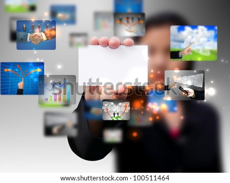 Businesswoman holding a business card - stock photo