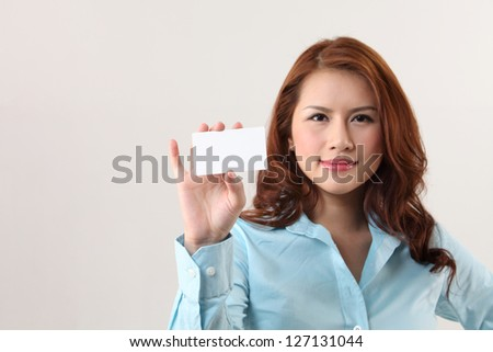 Businesswoman holding a card - stock photo