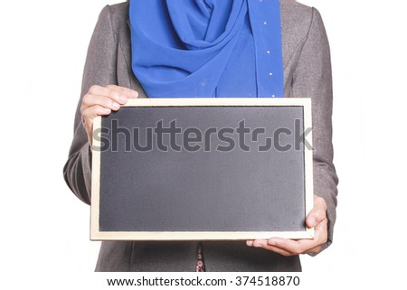 Businesswoman holding a chalk board