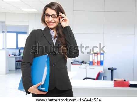 Businesswoman holding a document binder - stock photo
