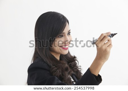 businesswoman holding a marker pen doing presentation - stock photo