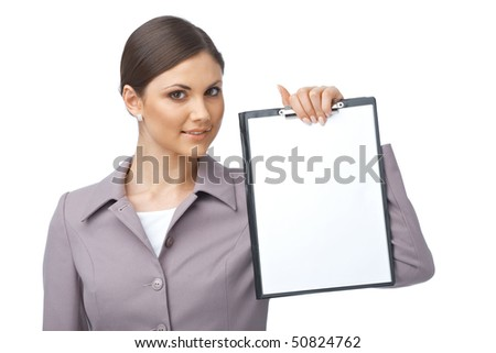 Businesswoman holding an empty clipboard over white background - stock photo