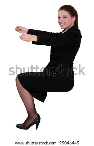 Businesswoman holding an invisible object - stock photo