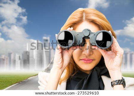 Businesswoman holding binoculars for search and check vision