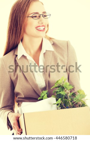 Businesswoman holding box with office items. - stock photo