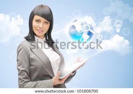 Businesswoman holding business world using tablet computer