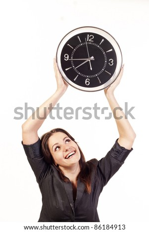 Businesswoman holding clock over white background - stock photo