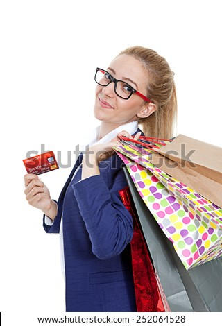 Businesswoman holding credit card with shopping bags on white background - stock photo