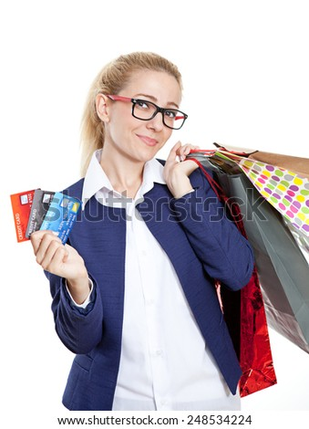 Businesswoman holding credit cards with shopping bags on white background - stock photo