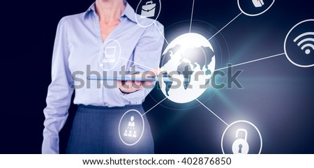 Businesswoman holding digital tablet against connected world - stock photo