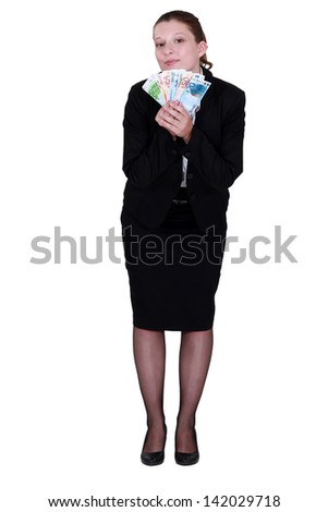 Businesswoman holding euro bank notes - stock photo