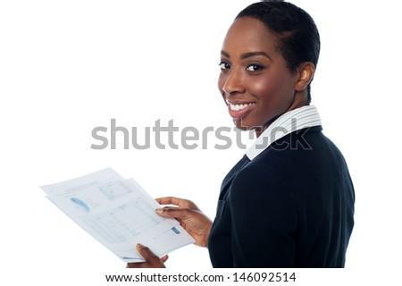 Businesswoman holding financial reports