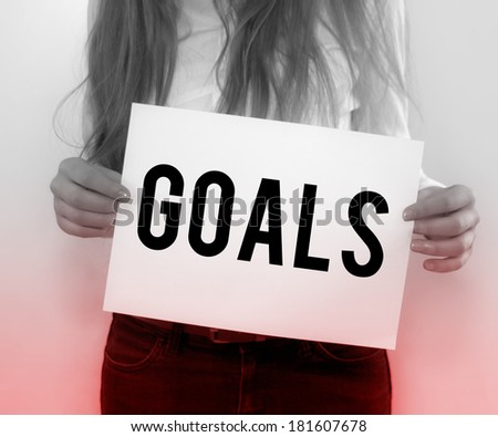 Businesswoman Holding Goals on Paper