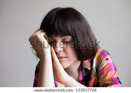 businesswoman holding her head in her hands, depression