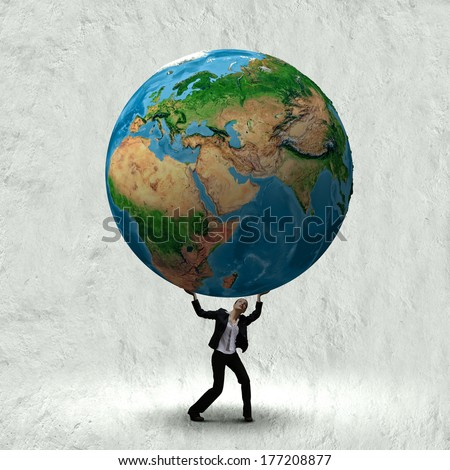 Businesswoman holding huge Earth planet above head. Elements of this image are furnished by NASA