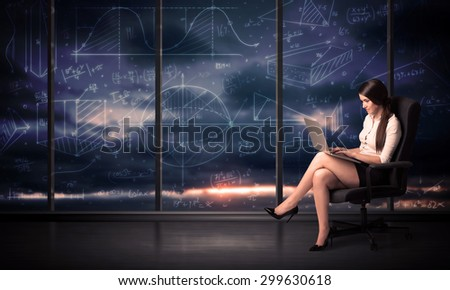 Businesswoman holding laptop in office room with graph charts on window concept - stock photo