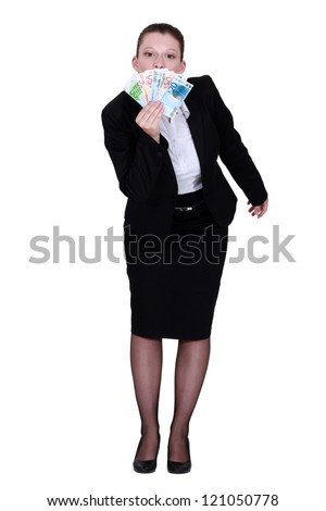 Businesswoman holding lots of bank notes - stock photo