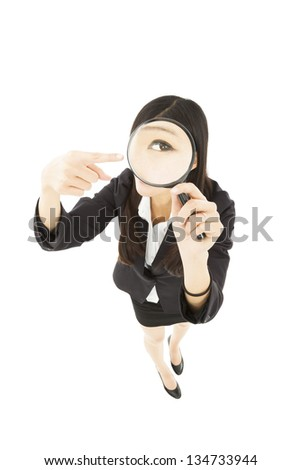 businessWoman holding Magnifying Glass and pointing