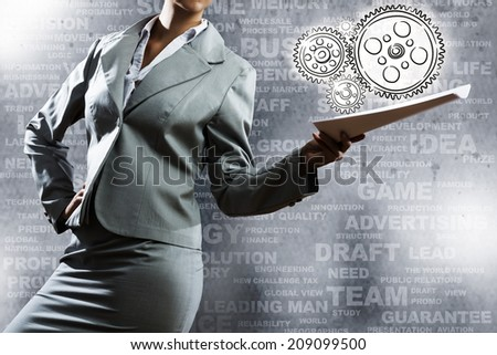 Businesswoman holding papers in hand and business sketches at background - stock photo