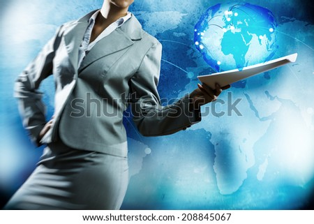 Businesswoman holding papers in hand and media background