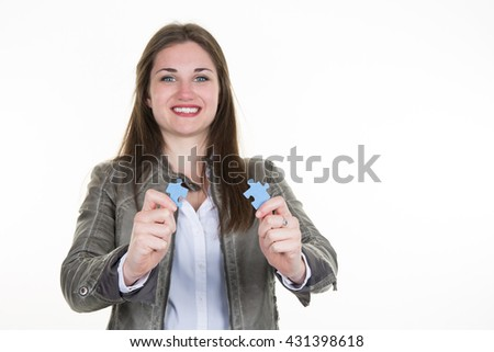 Businesswoman holding piece of grey puzzle isolated