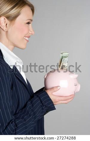 Businesswoman Holding Piggy Bank - stock photo