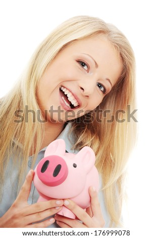 Businesswoman holding piggy bank. Isolated on white background