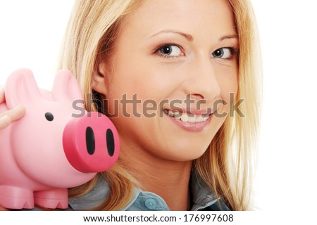 Businesswoman holding piggy bank. Isolated on white background . Focus on second eye - stock photo